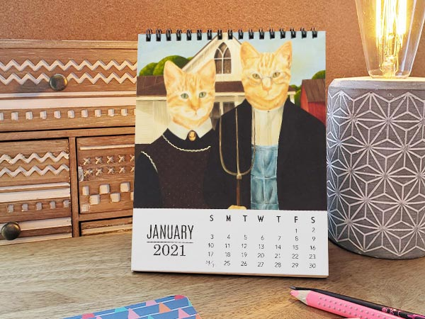 cat calendar on desk