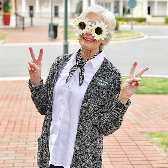 Paper Source Employee wearing fun sunglasses.