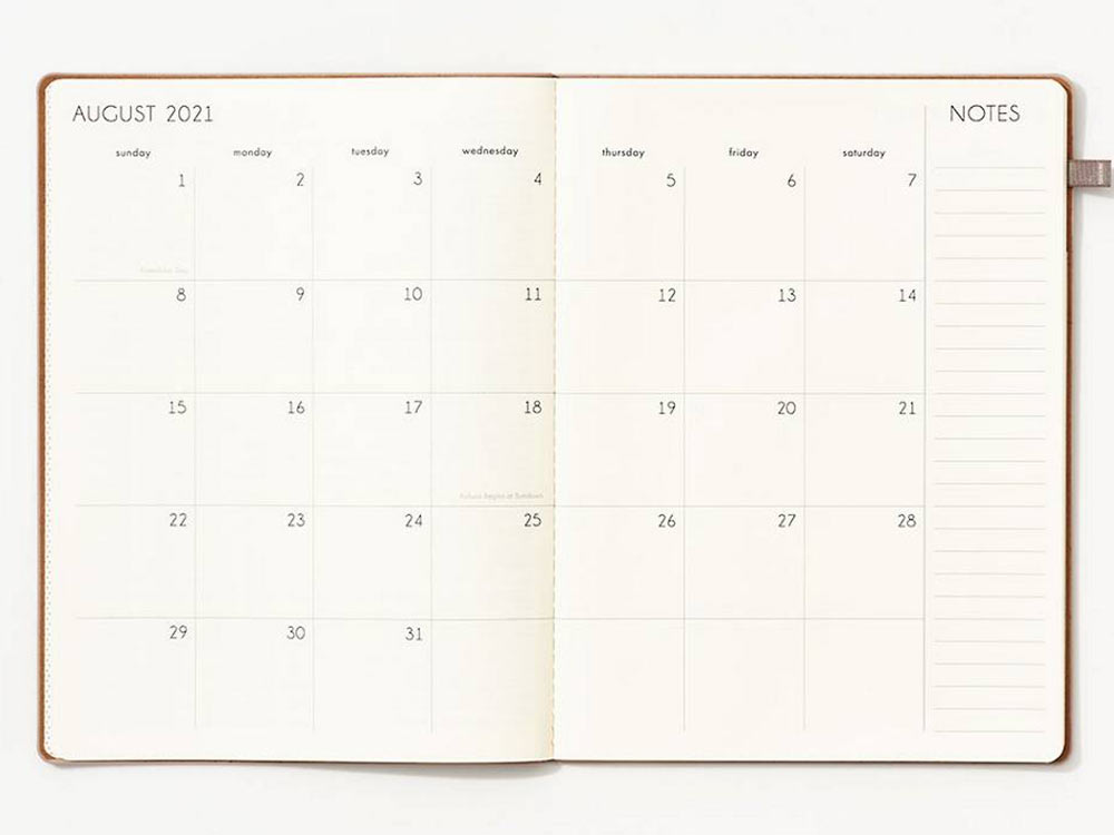 open planner showing month view.