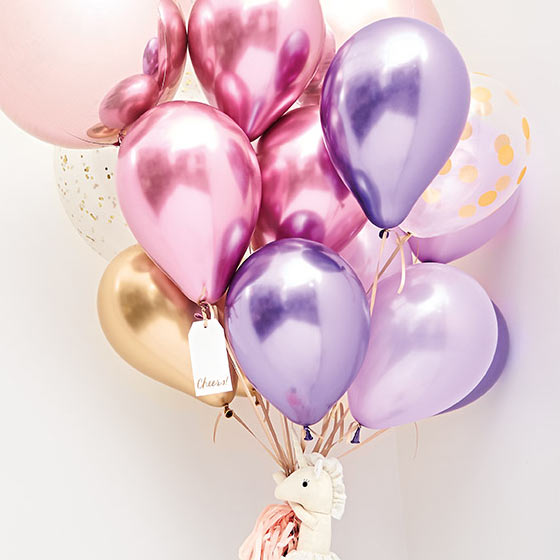 A bouquet of pink, purple and gold balloons