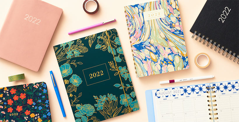 Assorted academic planners with stunning cover designs.