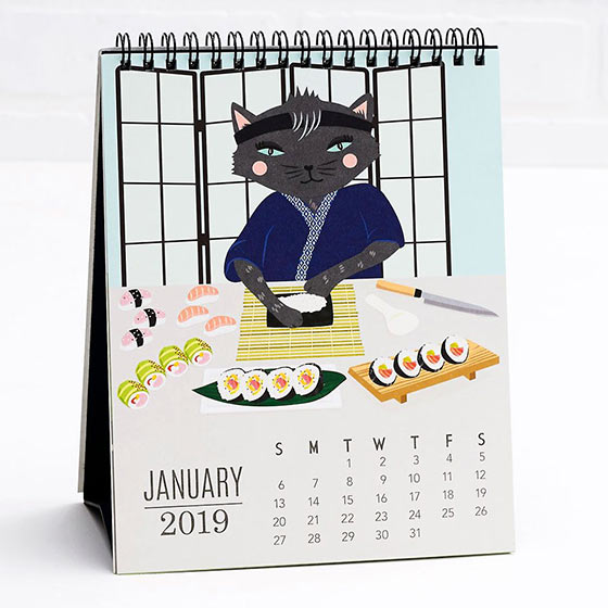 Desk calendar featuring illustrated cats