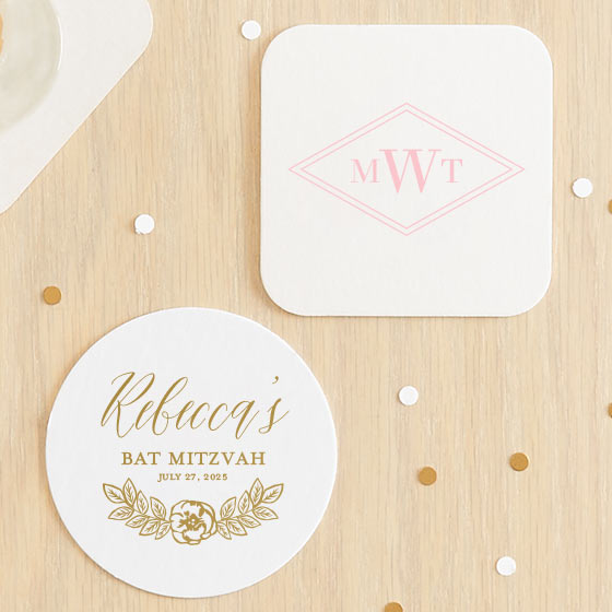 Customized coasters displayed on table with confetti.