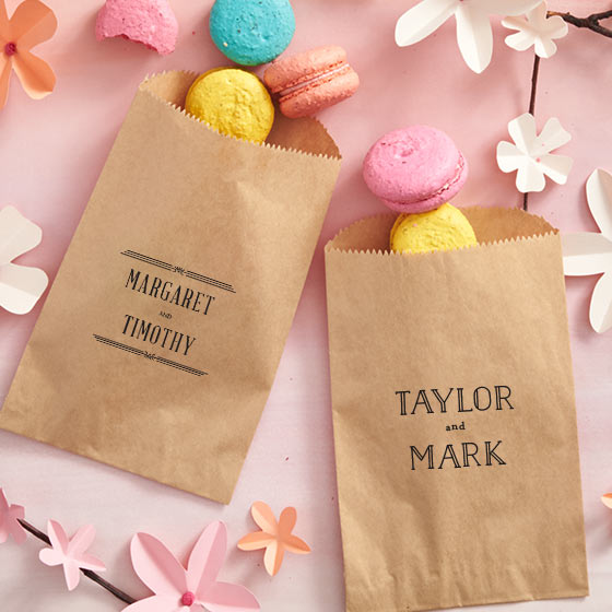 Customized favor bags displayed with treats spilling out.