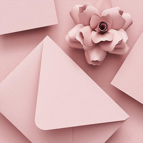 rose colored paper and envelopes