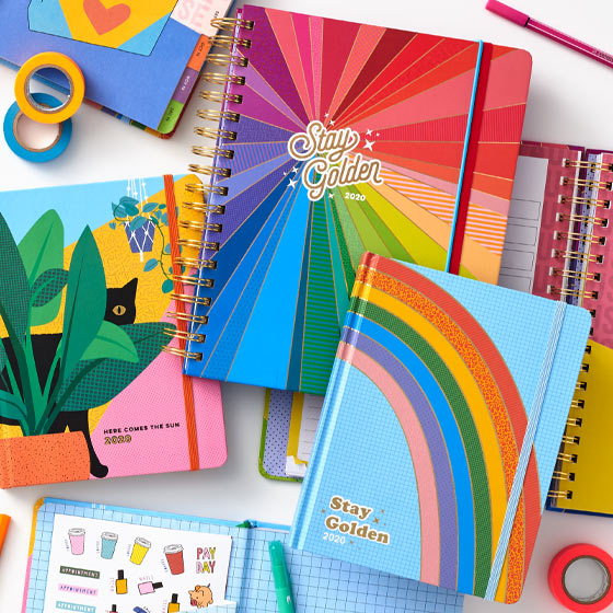 brightly colored calendars and planners