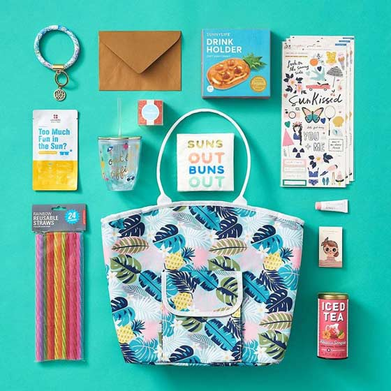 summer products on teal background