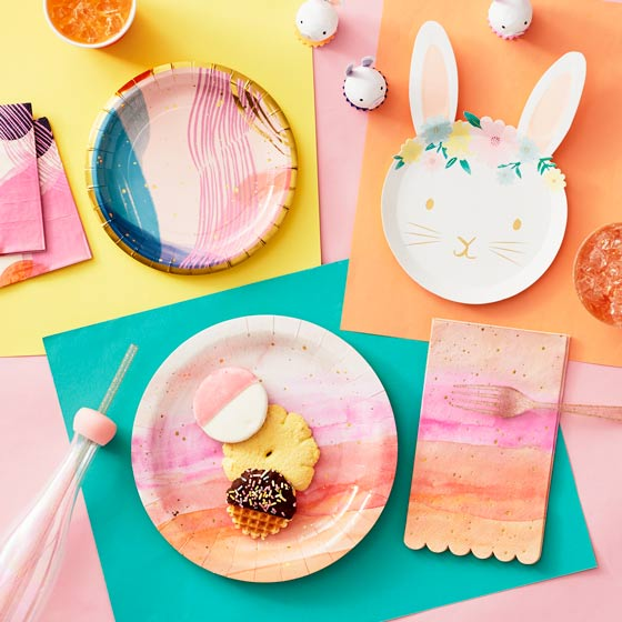 Array of colorful plates and napkins for a spring or Easter party