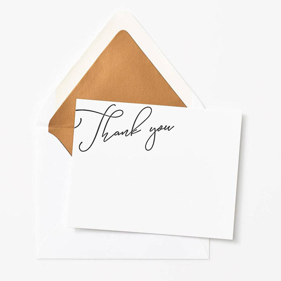 Custom Thank You Note shown on top of a gold foil lined envelope