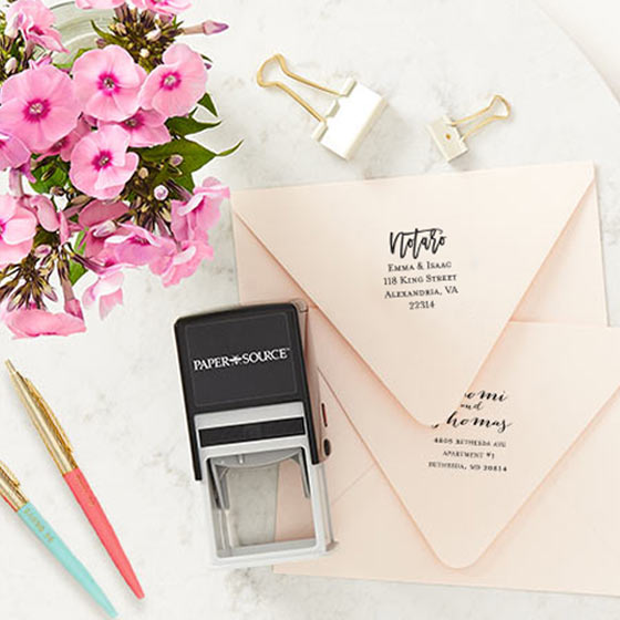 Custom Stamp tool shown with a custom address stamp on a luxe blush envelope.