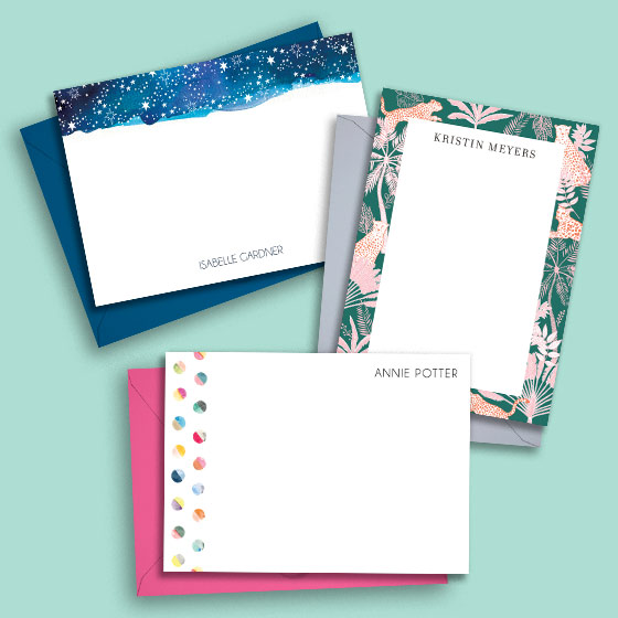 An array of custom stationery designs with colored envelopes