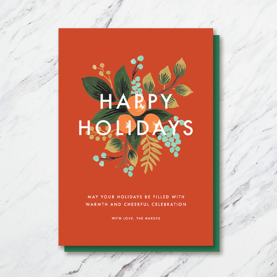 Custom Holiday Card that says Happy Holidays with ornate flowers designed behind the text