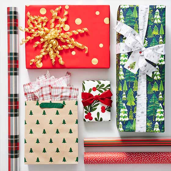 An array of Beautifully Wrapped Gifts in Holiday-Themed Wrapping Paper and Gift Bags