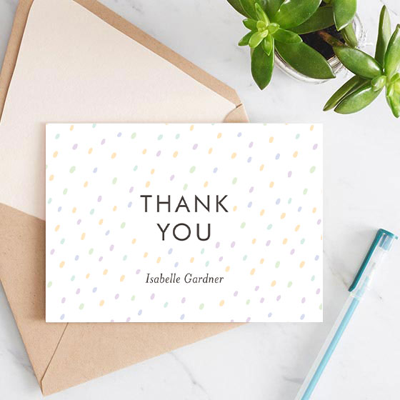 Customizable thank you note with a pastel dot pattern shown on an open envelope.