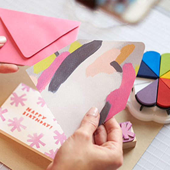 A still of a crafter creating their own stationery