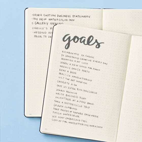 Journal opened to see a list of handwritten goals
