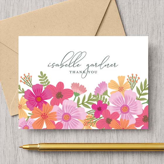 Customizable thank you note shown with garden blooms floral design.