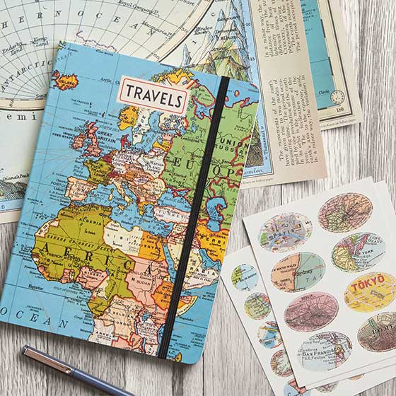 Travel themed products by Cavallini & Co. that include fine paper, a journal and stickers.