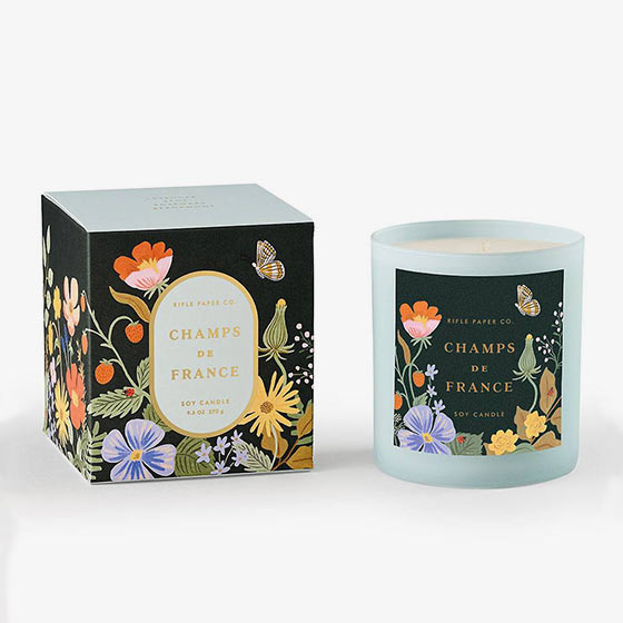 Champs de France candle features notes of lavender, sage, rosemary and bergamot in a painted glass vessel, packaged in a decorative box with gold foil accents.