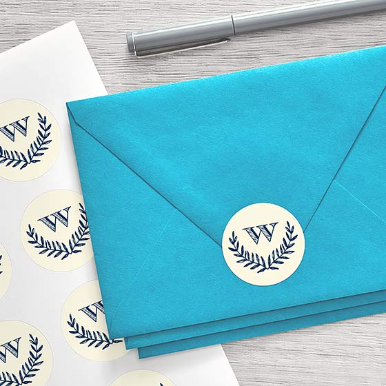Customizable Envelope Sticker with monogram design shown on a blue envelope.