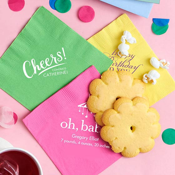 Colorful customized napkins displayed with party decorations.