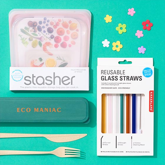 Assorted eco-friendly products like reusable glass straws and plantable paper flowers