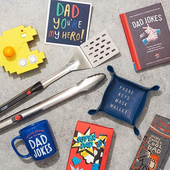 Assorted gifts for Fathers including a catchall, mug and cards.