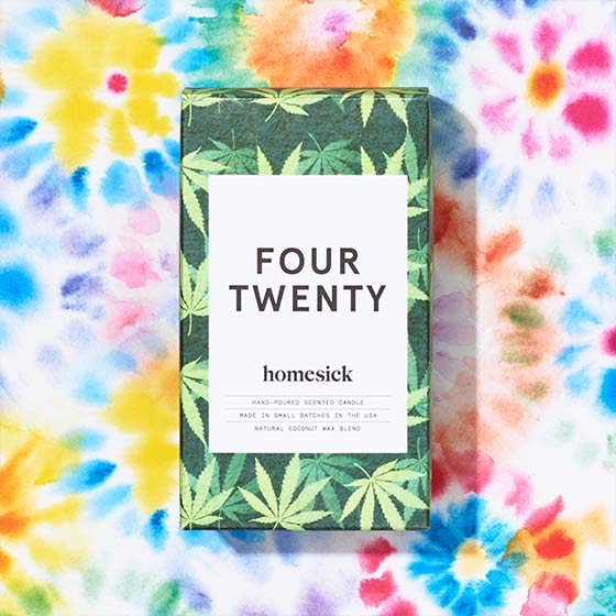 Four Twenty candle by Homesick Candles shown on a tie dye background.