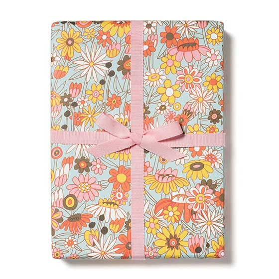 Groovy bloom flat wrapping paper featuring floral illustrations with a seventies-inspired design.