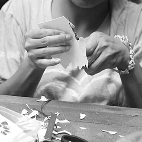 Image of person hand crafting a card for Good Paper.