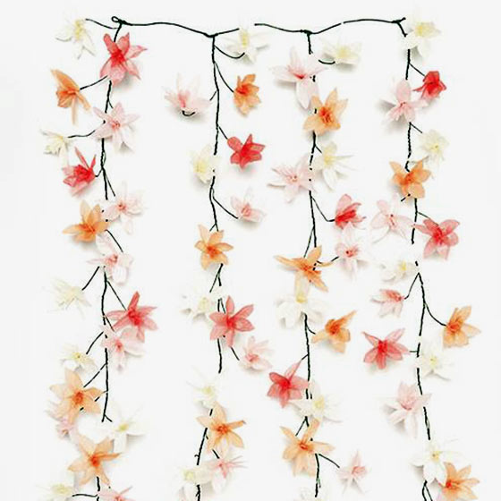 Paper flower garland featuring white, blush, orange, and white paper blooms.