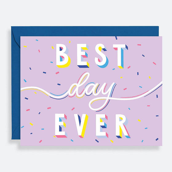Purple birthday greeting card with colorful confetti in the background that reads, Best Day Ever, in block letters and script.