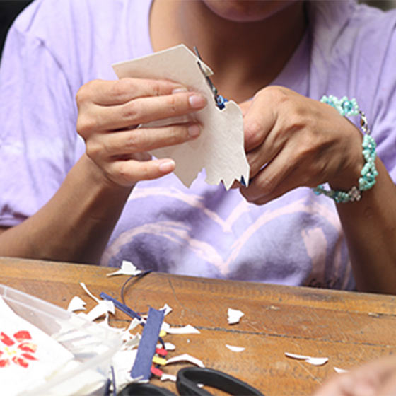 Shot of woman creating handmade cards for Good Paper.