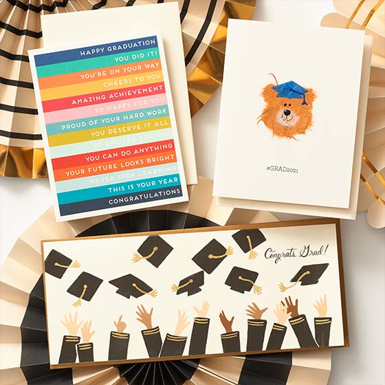 Graduation greeting cards, displaying a cute card, encouraging card, and a card for a money insert.