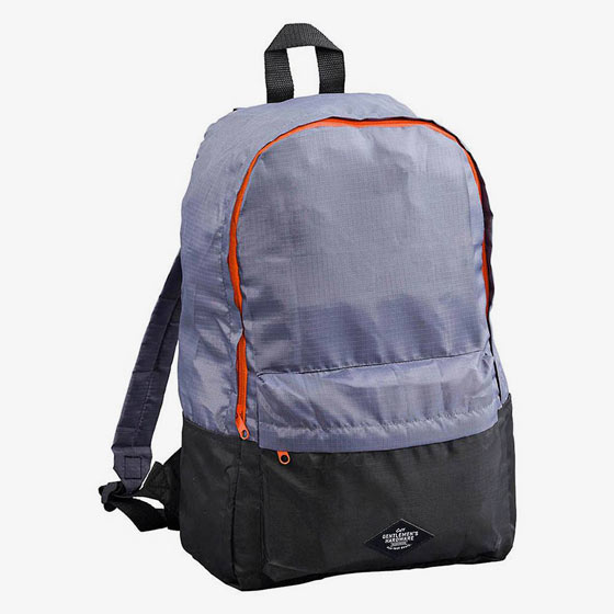 Contemporary grey backpack with orange trim details. Made of durable, water-resistant, ripstop polyester and features a zip front pocket.