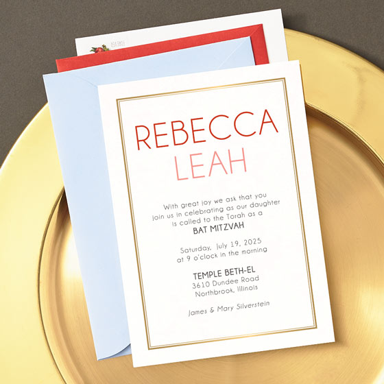 Bat Mitzvah invitation with gold foil border displayed on a gold plate on top of colorful envelopes.