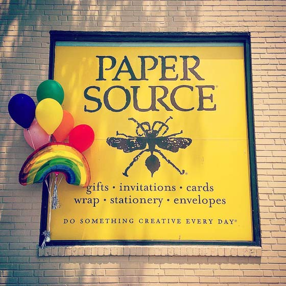 Paper Source building shown with rainbow balloons.