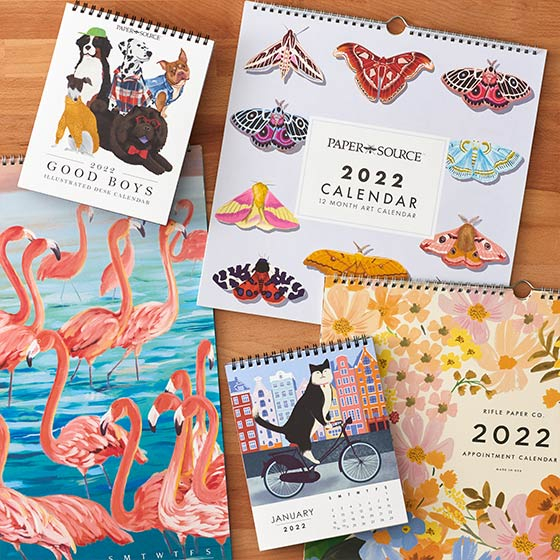 Collection of new assorted wall and desk calendars.