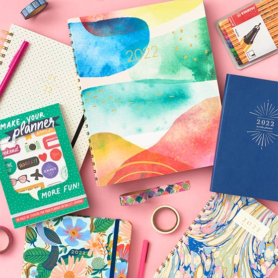 Colorful Planners with stylish and cute designs and assorted washi tape and stickers.
