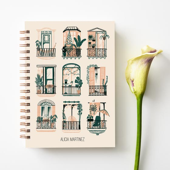 Customizable planner with windows design shown next to a flower.