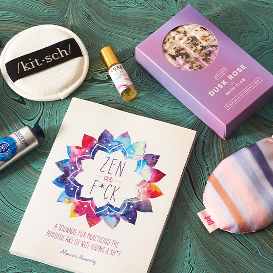 Assorted beauty products including a sleep mask and essential oil.