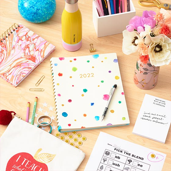 Desk set up with teacher themed items including a new lifestyle teacher planner.