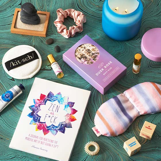 Assorted beauty and relaxing products like a face mask and essential oils.