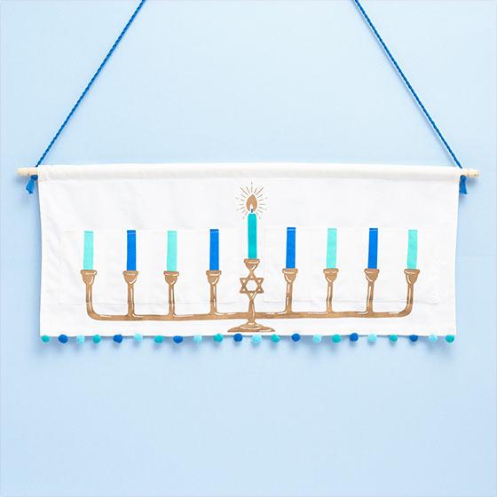 Hanging Hanukkah menorah.