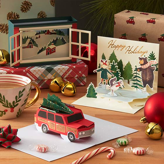 Popup holiday greeting cards featuring a station wagon with a Christmas tree on top.