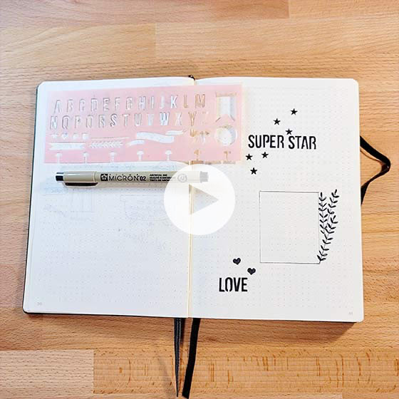 Opened journal shown with stenciling.