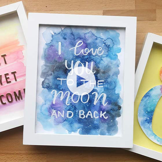 Framed painting with watercolor galaxy theme that reads, I love you to the moon and back.