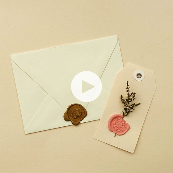 Envelopes and gift tags sealed with wax.