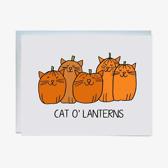 Halloween greeting card featuring orange cats made to look like pumpkins. Card reads, Cat O' Lanterns.